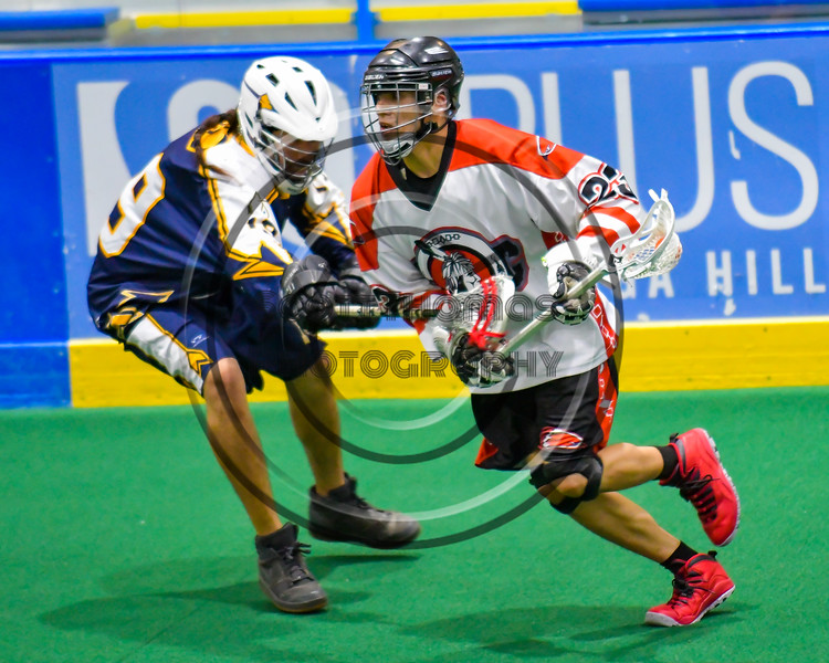 Onondaga Redhawks Troy Benedict (23) with the ball against the Allegany Arrows in Can-Am Box Lacrosse action at the Onondaga Nation Arena near Nedrow, New York on Saturday, May 14, 2016.  Onondaga won 17-5.