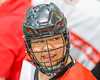 Onondaga Redhawks Junior Bucktooth (25) on the bench against the Allegany Arrows in Can-Am Box Lacrosse action at the Onondaga Nation Arena near Nedrow, New York on Saturday, May 14, 2016.  Onondaga won 17-5.