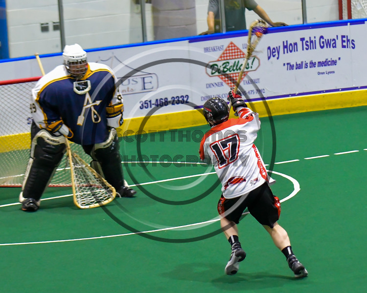Onondaga Redhawks Dan Rogers (17) shoots and scores agianst the Allegany Arrows in Can-Am Box Lacrosse action at the Onondaga Nation Arena near Nedrow, New York on Saturday, May 14, 2016.  Onondaga won 17-5.