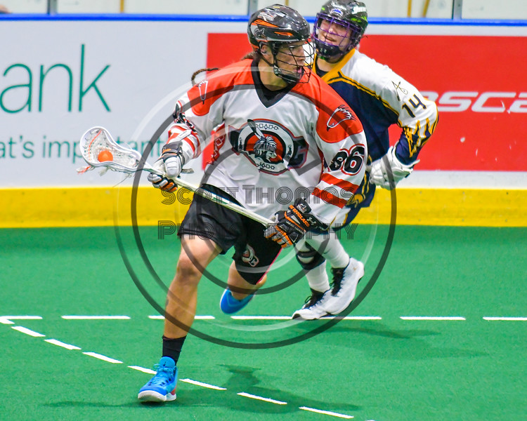 Onondaga Redhawks Bill O'Brien (96) with the ball against the Allegany Arrows in Can-Am Box Lacrosse action at the Onondaga Nation Arena near Nedrow, New York on Saturday, May 14, 2016.  Onondaga won 17-5.