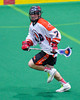 Onondaga Redhawks Derek Bennett (7) with the ball against the Allegany Arrows in Can-Am Box Lacrosse action at the Onondaga Nation Arena near Nedrow, New York on Saturday, May 14, 2016.  Onondaga won 17-5.