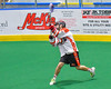 Onondaga Redhawks Derek Bennett (7) leans into a shot against Allegany Arrows in Can-Am Box Lacrosse action at the Onondaga Nation Arena near Nedrow, New York on Saturday, May 14, 2016.  Onondaga won 17-5.