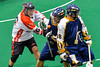 Onondaga Redhawks Vince Thomas (16) checks the ball away from an Allegany Arrows player in Can-Am Box Lacrosse action at the Onondaga Nation Arena near Nedrow, New York on Saturday, May 14, 2016.  Onondaga won 17-5.