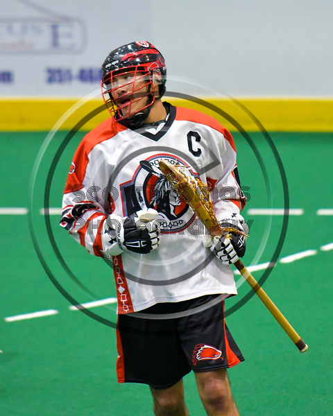 Onondaga Redhawks Brett Bucktooth (66) playing against the Allegany Arrows in Can-Am Box Lacrosse action at the Onondaga Nation Arena near Nedrow, New York on Saturday, May 14, 2016.  Onondaga won 17-5.