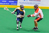 Onondaga Redhawks Ryan Lewis (8) defending against the Allegany Arrows in Can-Am Box Lacrosse action at the Onondaga Nation Arena near Nedrow, New York on Saturday, May 14, 2016.  Onondaga won 17-5.