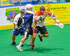 Onondaga Redhawks Brett Bucktooth (66) breaks away from Allegany Arrows defenders in Can-Am Box Lacrosse action at the Onondaga Nation Arena near Nedrow, New York on Saturday, May 14, 2016.  Onondaga won 17-5.