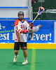 Onondaga Redhawks Derek Bennett (7) passing the ball against the Allegany Arrows in Can-Am Box Lacrosse action at the Onondaga Nation Arena near Nedrow, New York on Saturday, May 14, 2016.  Onondaga won 17-5.