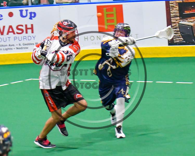 Onondaga Redhawks Brett Bucktooth (66) passes behind his back against the Allegany Arrows in Can-Am Box Lacrosse action at the Onondaga Nation Arena near Nedrow, New York on Saturday, May 14, 2016.  Onondaga won 17-5.
