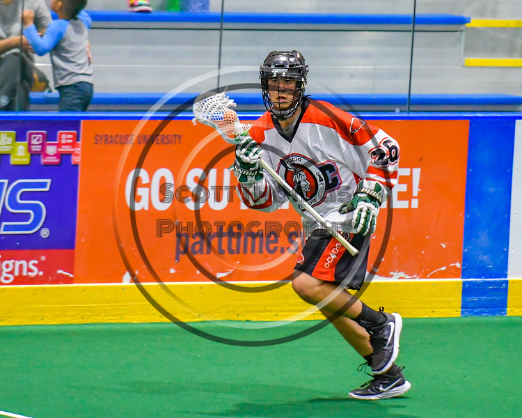 Onondaga Redhawks Max Wagner (26) with the ball against the Allegany Arrows in Can-Am Box Lacrosse action at the Onondaga Nation Arena near Nedrow, New York on Saturday, May 14, 2016.  Onondaga won 17-5.