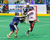 Onondaga Redhawks Vince Thomas (16) fires the ball against the Allegany Arrows in Can-Am Box Lacrosse action at the Onondaga Nation Arena near Nedrow, New York on Saturday, May 14, 2016.  Onondaga won 17-5.