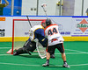 Onondaga Redhawks Brian Phillips Jr. (44) lines up a shot at the Allegany Arrows net in Can-Am Box Lacrosse action at the Onondaga Nation Arena near Nedrow, New York on Saturday, May 14, 2016.  Onondaga won 17-5.