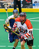 Onondaga Redhawks Luke Thompson (14) with the ball against the Allegany Arrows in Can-Am Box Lacrosse action at the Onondaga Nation Arena near Nedrow, New York on Saturday, May 14, 2016.  Onondaga won 17-5.