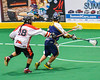 Onondaga Redhawks AJ Bucktooth (18) knocks the ball away from an Allegany Arrows player in Can-Am Box Lacrosse action at the Onondaga Nation Arena near Nedrow, New York on Saturday, May 14, 2016.  Onondaga won 17-5.