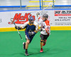 Onondaga Redhawks Troy Benedict (23) defending against the Allegany Arrows in Can-Am Box Lacrosse action at the Onondaga Nation Arena near Nedrow, New York on Saturday, May 14, 2016.  Onondaga won 17-5.