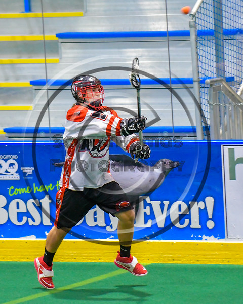 Onondaga Redhawks Cameron Simpson (5) passing the ball against the Allegany Arrows in Can-Am Box Lacrosse action at the Onondaga Nation Arena near Nedrow, New York on Saturday, May 14, 2016.  Onondaga won 17-5.