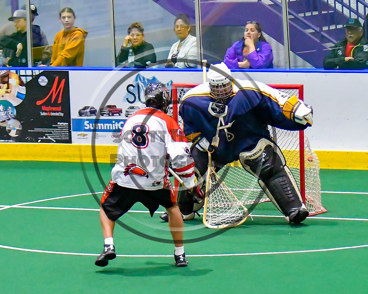 Onondaga Redhawks Ryan Lewis (8) scores against the Allegany Arrows in Can-Am Box Lacrosse action at the Onondaga Nation Arena near Nedrow, New York on Saturday, May 14, 2016.  Onondaga won 17-5.
