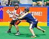 Onondaga Redhawks Brian Phillips Jr. (44) with the ball against the Allegany Arrows in Can-Am Box Lacrosse action at the Onondaga Nation Arena near Nedrow, New York on Saturday, May 14, 2016.  Onondaga won 17-5.