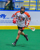 Onondaga Redhawks Grant Bucktooth (15) with the ball against the Allegany Arrows in Can-Am Box Lacrosse action at the Onondaga Nation Arena near Nedrow, New York on Saturday, May 14, 2016.  Onondaga won 17-5.