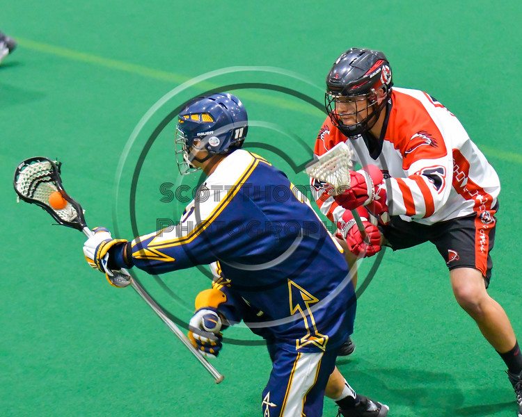 Onondaga Redhawks Grant Bucktooth (15) defending against the Allegany Arrows in Can-Am Box Lacrosse action at the Onondaga Nation Arena near Nedrow, New York on Saturday, May 14, 2016.  Onondaga won 17-5.