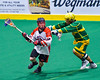 Onondaga Redhawks Dan Rogers (17) keeps the ball away from a Newtown Golden Eagles player in Can-Am Box Lacrosse action at the Onondaga Nation Arena near Nedrow, New York on Saturday, July 9, 2016.  Onondaga won 14-6.