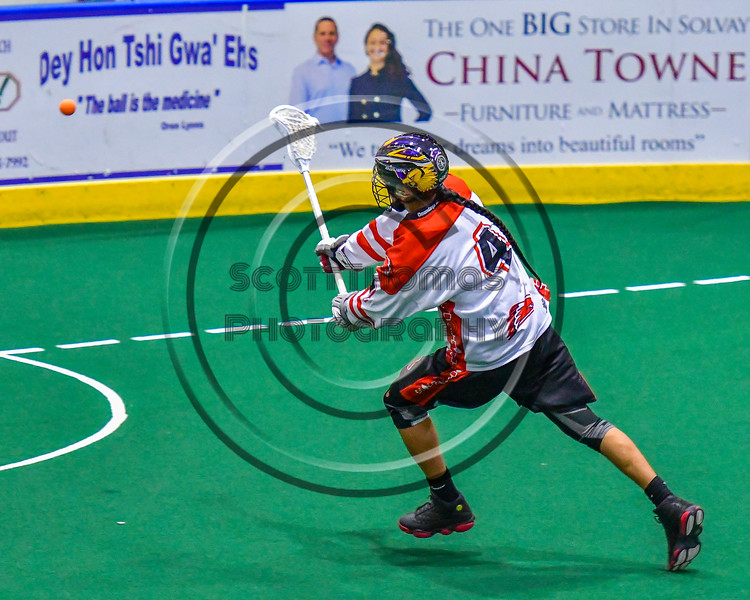 Onondaga Redhawks Lyle Thompson (4) shoots on the Newtown Golden Eagles net in Can-Am Box Lacrosse action at the Onondaga Nation Arena near Nedrow, New York on Saturday, July 9, 2016.  Onondaga won 14-6.