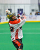 Onondaga Redhawks Hiana Thompson (22) winding up for a shot at the Newtown Golden Eagles net in Can-Am Box Lacrosse action at the Onondaga Nation Arena near Nedrow, New York on Saturday, July 9, 2016.  Onondaga won 14-6.