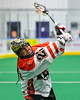 Onondaga Redhawks Hiana Thompson (22) leaning into a shot at the Newtown Golden Eagles net in Can-Am Box Lacrosse action at the Onondaga Nation Arena near Nedrow, New York on Saturday, July 9, 2016.  Onondaga won 14-6.