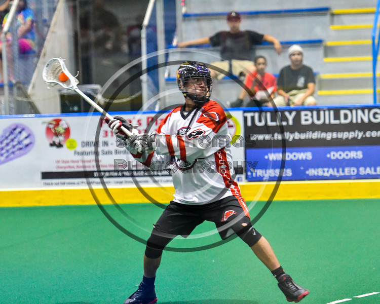 Onondaga Redhawks Lyle Thompson (4) winds up for a shoot at the Newtown Golden Eagles net in Can-Am Box Lacrosse action at the Onondaga Nation Arena near Nedrow, New York on Saturday, July 9, 2016.  Onondaga won 14-6.