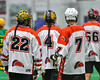 Onondaga Redhawks players Hiana Thompson (22), Lyle Thompson (4), Leroy Halftown (7) and Brett Bucktooth (66) after a goal against the Newtown Golden Eagles in Can-Am Box Lacrosse action at the Onondaga Nation Arena near Nedrow, New York on Saturday, July 9, 2016.  Onondaga won 14-6.