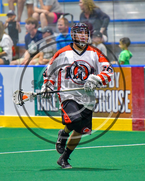 Onondaga Redhawks Vince Thomas (16) with the ball against the Newtown Golden Eagles in Can-Am Box Lacrosse action at the Onondaga Nation Arena near Nedrow, New York on Saturday, July 9, 2016.  Onondaga won 14-6.