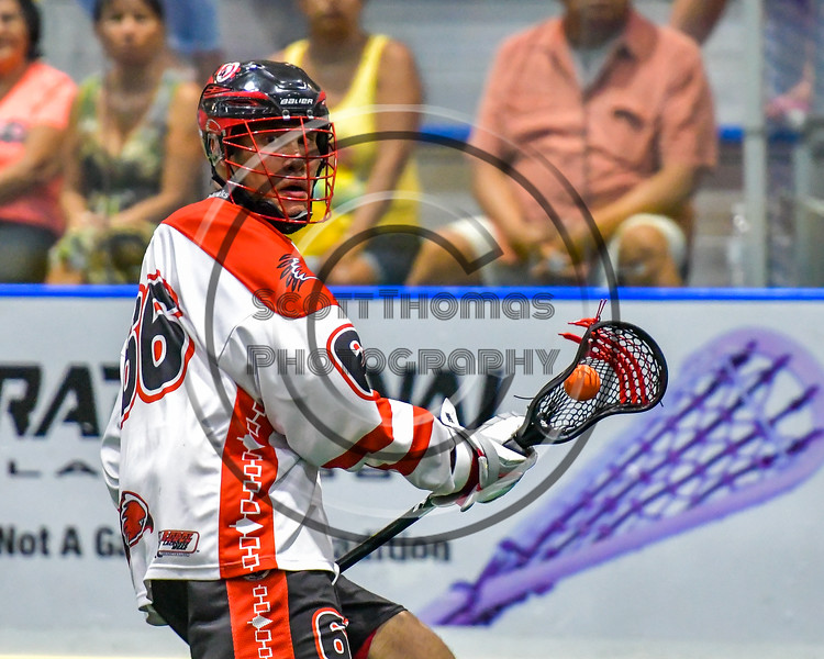 Onondaga Redhawks Brett Bucktooth (66) looking to make a play against the Newtown Golden Eagles in Can-Am Box Lacrosse action at the Onondaga Nation Arena near Nedrow, New York on Saturday, July 9, 2016.  Onondaga won 14-6.