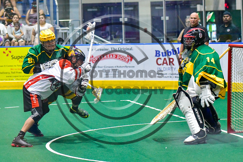 Onondaga Redhawks Lyle Thompson (4) leans in for a shot at the Newtown Golden Eagles net in Can-Am Box Lacrosse action at the Onondaga Nation Arena near Nedrow, New York on Saturday, July 9, 2016.  Onondaga won 14-6.