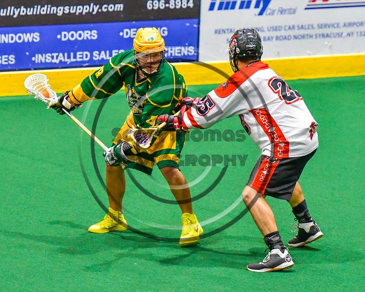 Onondaga Redhawks Junior Bucktooth (25) defending abainst the Newtown Golden Eagles in Can-Am Box Lacrosse action at the Onondaga Nation Arena near Nedrow, New York on Saturday, July 9, 2016.  Onondaga won 14-6.