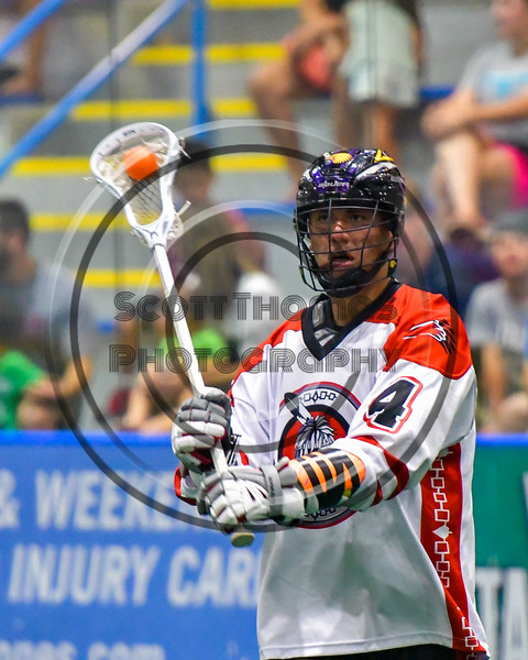 Onondaga Redhawks Lyle Thompson (4) passing the ball against the Newtown Golden Eagles in Can-Am Box Lacrosse action at the Onondaga Nation Arena near Nedrow, New York on Saturday, July 9, 2016.  Onondaga won 14-6.
