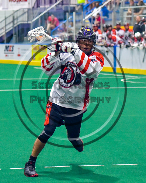 Onondaga Redhawks Lyle Thompson (4) moves in for a shot against the Newtown Golden Eagles in Can-Am Box Lacrosse action at the Onondaga Nation Arena near Nedrow, New York on Saturday, July 9, 2016.  Onondaga won 14-6.