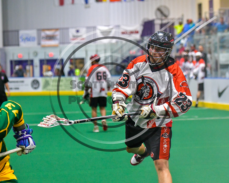 Onondaga Redhawks Troy Benedict (23) after a shot against the Newtown Golden Eagles in Can-Am Box Lacrosse action at the Onondaga Nation Arena near Nedrow, New York on Saturday, July 9, 2016.  Onondaga won 14-6.