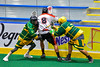 Onondaga Redhawks Drew Bucktooth (8) keeping the ball away from a pair of Newtown Golden Eagles defenders in Can-Am Box Lacrosse action at the Onondaga Nation Arena near Nedrow, New York on Saturday, July 9, 2016.  Onondaga won 14-6.