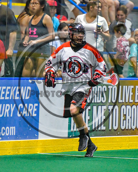 Onondaga Redhawks Drew Bucktooth (8) with the ball against the Newtown Golden Eagles in Can-Am Box Lacrosse action at the Onondaga Nation Arena near Nedrow, New York on Saturday, July 9, 2016.  Onondaga won 14-6.