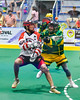 Onondaga Redhawks Brett Bucktooth (66) passing the ball against the Newtown Golden Eagles in Can-Am Box Lacrosse action at the Onondaga Nation Arena near Nedrow, New York on Saturday, July 9, 2016.  Onondaga won 14-6.
