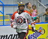 Onondaga Redhawks Hiana Thompson (22) with the ball against the Newtown Golden Eagles in Can-Am Box Lacrosse action at the Onondaga Nation Arena near Nedrow, New York on Saturday, July 9, 2016.  Onondaga won 14-6.