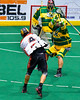 Onondaga Redhawks Lyle Thompson (4) fires a shot at the Newtown Golden Eagles net in Can-Am Box Lacrosse action at the Onondaga Nation Arena near Nedrow, New York on Saturday, July 9, 2016.  Onondaga won 14-6.
