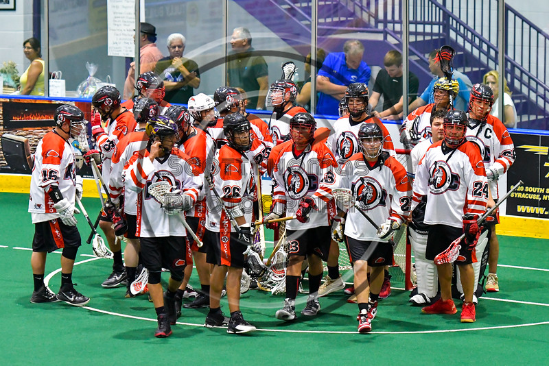 Onondaga Redhawks break their pre-game huddle before playing the Newtown Golden Eagles in Can-Am Box Lacrosse action at the Onondaga Nation Arena near Nedrow, New York on Saturday, July 9, 2016.