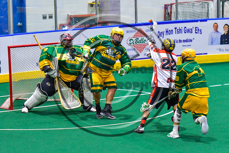 Onondaga Redhawks Hiana Thompson (22) shoots and scores against the Newtown Golden Eagles in Can-Am Box Lacrosse action at the Onondaga Nation Arena near Nedrow, New York on Saturday, July 9, 2016.  Onondaga won 14-6.