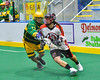 Onondaga Redhawks Cameron Simpson (5) with the ball against the Newtown Golden Eagles in Can-Am Box Lacrosse action at the Onondaga Nation Arena near Nedrow, New York on Saturday, July 9, 2016.  Onondaga won 14-6.