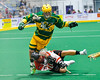Onondaga Redhawks Cameron Simpson (5) gets tripped up against the Newtown Golden Eagles in Can-Am Box Lacrosse action at the Onondaga Nation Arena near Nedrow, New York on Saturday, July 9, 2016.  Onondaga won 14-6.