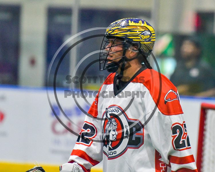 Onondaga Redhawks Hiana Thompson (22) playing against the Newtown Golden Eagles in Can-Am Box Lacrosse action at the Onondaga Nation Arena near Nedrow, New York on Saturday, July 9, 2016.  Onondaga won 14-6.