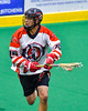Onondaga Redhawks Grant Bucktooth (15) with the ball against the Newtown Golden Eagles in Can-Am Box Lacrosse action at the Onondaga Nation Arena near Nedrow, New York on Saturday, July 9, 2016.  Onondaga won 14-6.