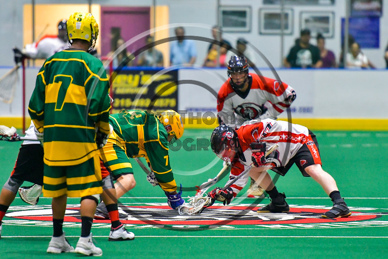 Onondaga Redhawks Dan Rogers (17) facing off against the Newtown Golden Eagles in Can-Am Box Lacrosse action at the Onondaga Nation Arena near Nedrow, New York on Saturday, July 9, 2016.  Onondaga won 14-6.