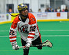Onondaga Redhawks Hiana Thompson (22) after a shot at the Newtown Golden Eagles net in Can-Am Box Lacrosse action at the Onondaga Nation Arena near Nedrow, New York on Saturday, July 9, 2016.  Onondaga won 14-6.