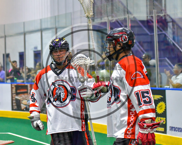 Onondaga Redhawks Lyle Thompson (4) gets congratulated by Grant Bucktooth (15) after scoring a goal against the Newtown Golden Eagles in Can-Am Box Lacrosse action at the Onondaga Nation Arena near Nedrow, New York on Saturday, July 9, 2016.  Onondaga won 14-6.